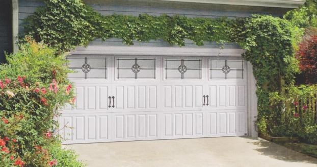 Decorative window panels can turn your garage into a focal point rather than an eyesore.